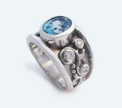 Blue Zircon, Diamonds, gold swirl engagement ring