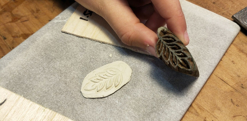 Stamping the clay