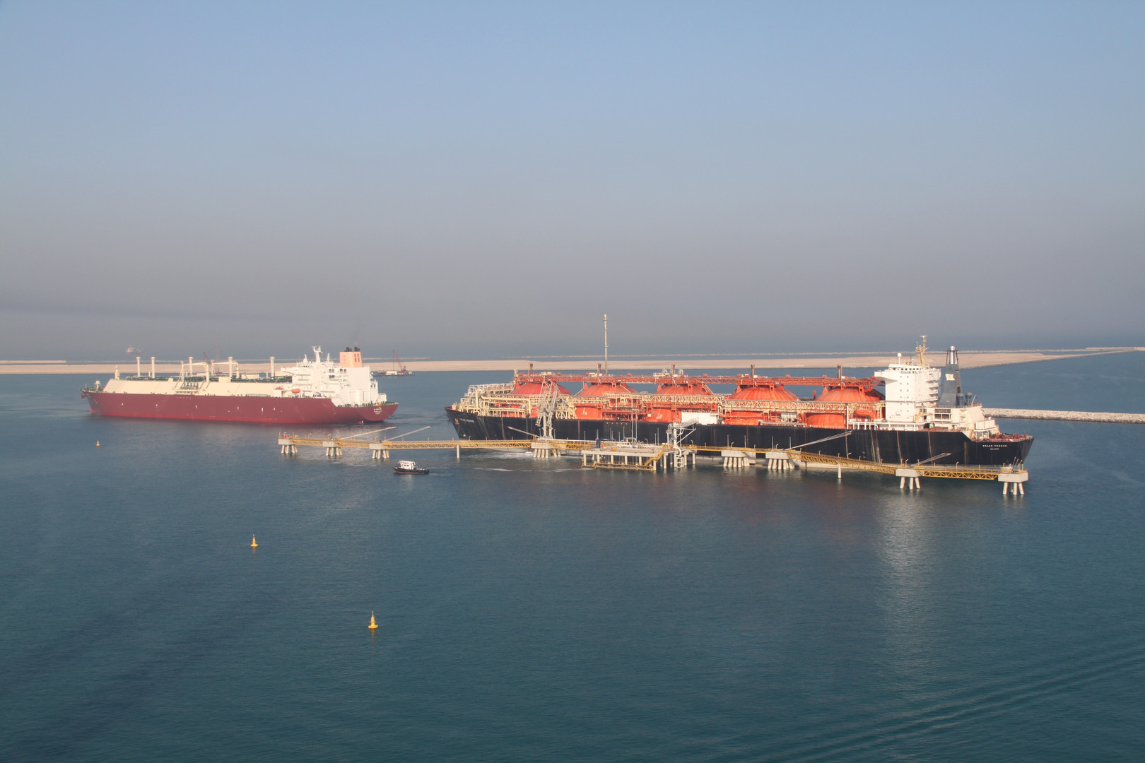 """Qatargas LNG carrier Al Bahiya delivery of commissioning cargo to Regasification vessel Golar Freeze"""