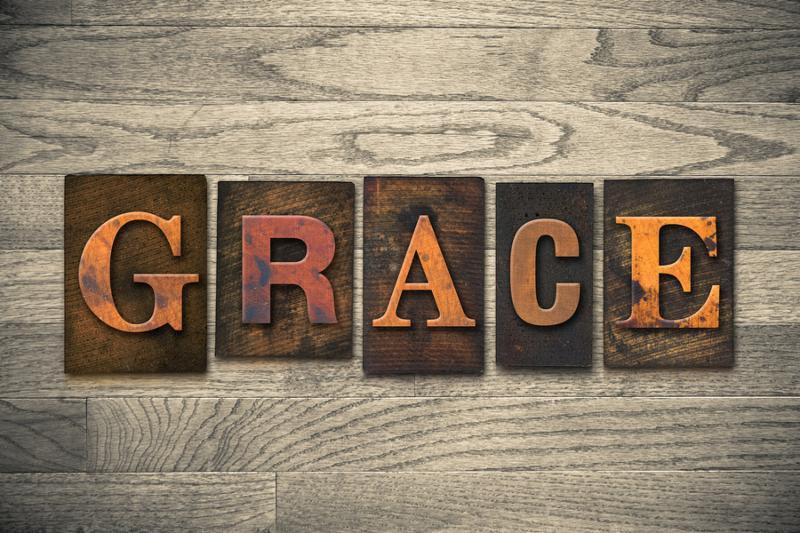 The word GRACE written in wooden letterpress type.
