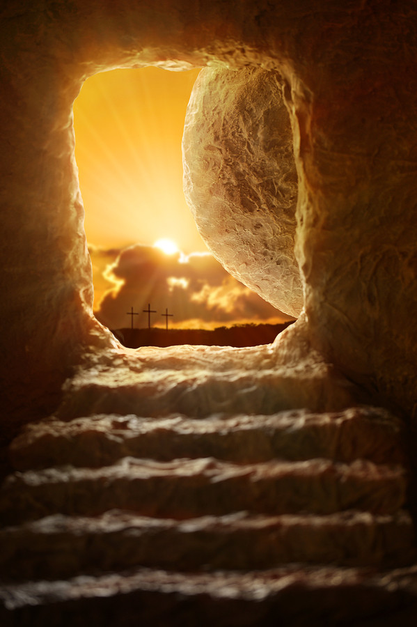 Open tomb of Jesus with sun appearing through entrance - Shallow
