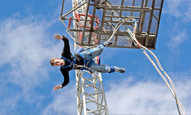 Man falling to ground at end of Bungee Jump
