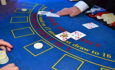 Closeup of Card dealer at Casino