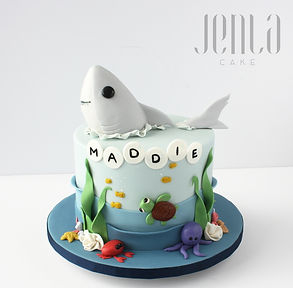 Don't worry, this cute shark is made out of cake for a little girl's first birthday; under the sea theme!