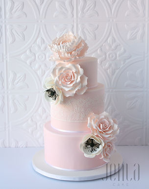 Originally designed by Leslies Matsis, this cake features edible lace and gorgeous sugar roses and anemonies with an extra large peony perched atop