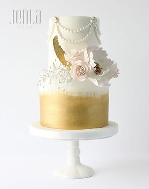 With brushed gold fondant, edible pearls, feathers and the softest pink flowers, this 2-tier cake is perfect for an intimate gathering.