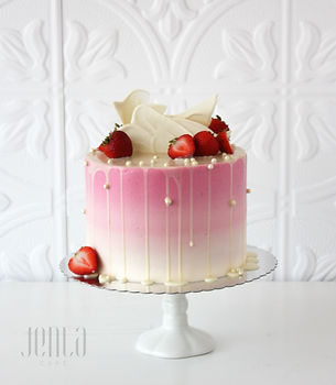 Strawberries and Cream; this cake has an ombre buttercream finish and topped with chocolate sails, fresh berries and a white chocolate drip