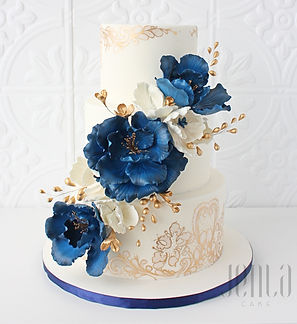 Luscious blooms of navy blue suagr flowers add drama while gold and ivory hand painted details adds a touch of softness on this 3-tier wedding cake - JENLA Cake, Toronto