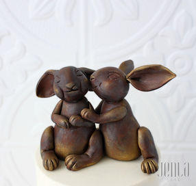 These cute bunnies are edible replicas of an antique figuerine the couple wanted to incorporate on thier wedding cake. A final dusting of gold adds a touch of luxury - JENLA Cake, Toronto