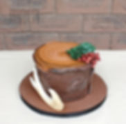 Perfect for the woodsy type, this cake resembels a tree stump with succulents and berries made from sugar
