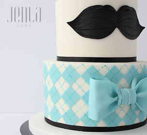 Teal argyle and a moustache adorn this baby shower cake to welcome a new lil' man