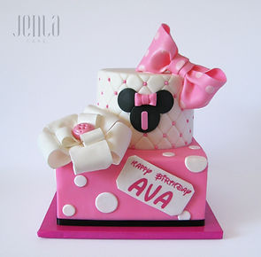 The perfect pink polka dot and bow tie Minnie Mouse cake for a birthday celebration