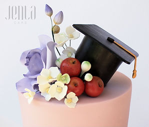 This hand painted chalkboard cake was perfect for a teacher's college grad. The perfect cake topper included sugar roses, a grad hat and of course, apples!