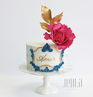 Inspired by decorative Portuguese tiles, this cake's vibrant blue is complemented by bright pink peonies and gold details.