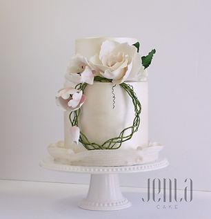 A brushed satin finish and floral crown made of sugar are all that's needed for this elegant wedding cake.