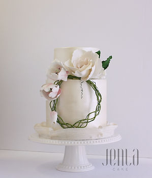 A brushed satin finish and floral crown made of sugar are all that's needed for this elegant wedding cake. - JENLA Cake, Toronto