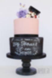 This hand painted chalkboard cake was perfect for a teacher's college grad.