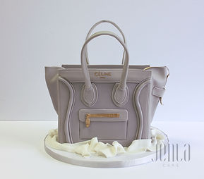 Replica Celine purse carved from choclate cake with stand up handles and gold zippers