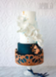This cake features hand cut cork detailing over navy and blue marbled tiers. White sugar flowers lighten up the look while hints of copper add a modern touch. Weddingbells Canada's Prettiest Cakes 2016. - JENLA Cake, Toronto