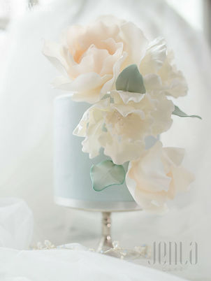 Featured in Elegant Wedding magazine, soft blue hues with pearls and delicate suagr flowers bring a feeling of serenity to this wedding cake. - JENLA Cake, Toronto