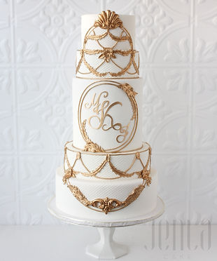 Ornate gold details beautifully frames the couple's custom made monogram on this towering 6 tier wedding cake - JENLA Cake, Toronto