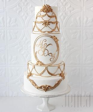 Ornate gold details beautifully frames the couple's custom made monogram on this towering 6 tier wedding cake - JENLA Cake, Toronto