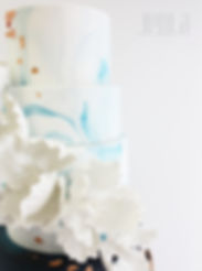 Blue fondant marbling, white sugar flowers, and touches of copper - JENLA Cake, Toronto