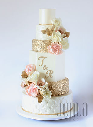 This grand 6-tier weding cake features edible gold sequins, a handcut monogram and beautiful sugar flowers including David Austin Roses. - JENLA Cake, Toronto