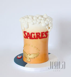 Cake carved into a pint of Sagres beer from Portugal and the Azorean flag adorning the cake board.