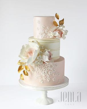 Edible lace applique becomes even more romanic with soft blush and ivory tones in this cake. Gold leaves and a brushed satin finish give this cake a touch of class. - JENLA Cake, Toronto