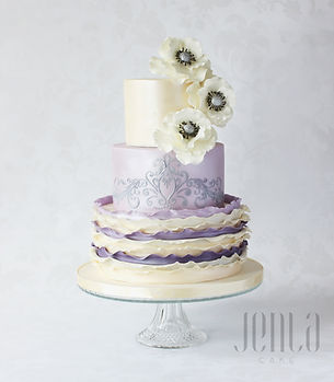 Purple ombre frill, silver filigree and a brushed satin finish are the perfect backdrop for sugar anemonies cascading from the top of this cake.  - JENLA Cake, Toronto