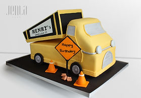 Construction truck scultped from cake