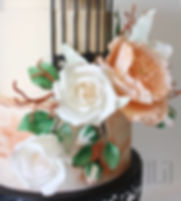 A garden of sugar roses blooms along an edible trellis. Hints of copper give this cake a rustic, yet polished look. - JENLA Cake, Toronto