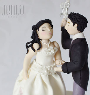 These handcrafted wedding cake toppers are intricately detailed and made to resemble the bride and groom - JENLA Cake, Toronto