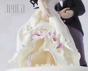 These handcrafted wedding cake toppers are intricately detailed and made to resemble the bride and groom - JENLA ake, Toronto