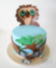 Doing what a sloth does best, tree hugging. A Croods themed cake featuring Belt, the sloth!