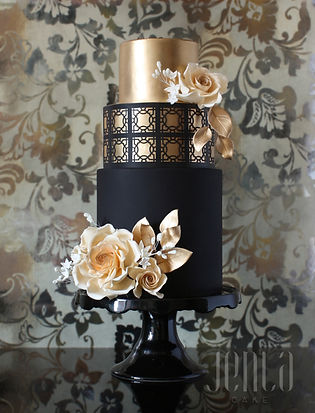 Dramatic and bold, this black and gold cake features carefully cut lattice details and beautiful sugar roses. - JENLA Cake, Toronto