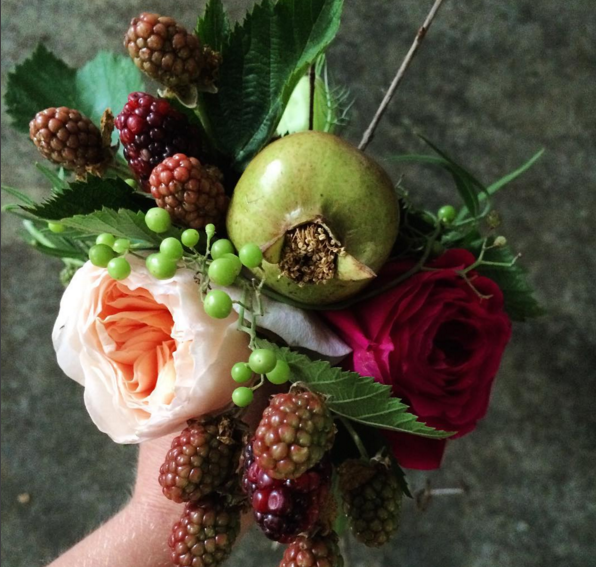 Bouquet with blackberries and pomegranantes