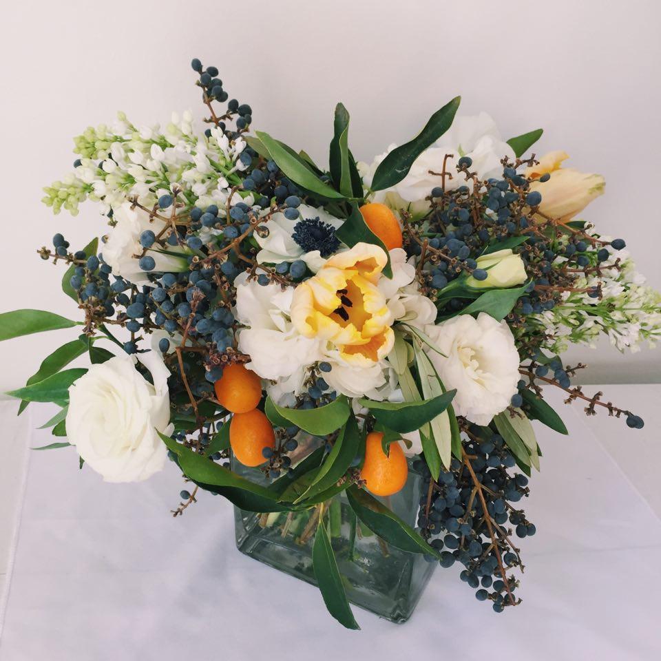 Arrangement with kumquats and berries.