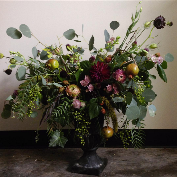 Romantic arrangement with pomegranates.
