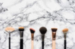 makeup-brushes-on-white-marble-backgroun