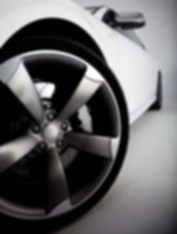 Picture of a white sports car focusing