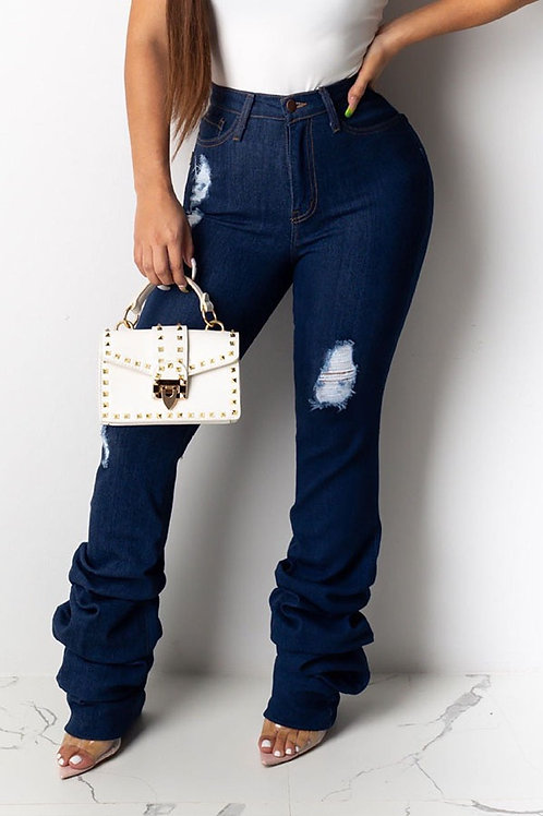 Ruffle bottom ripped jeans