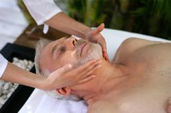 Senior man having facial massage