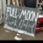 full moon and buck naked sign.jpg