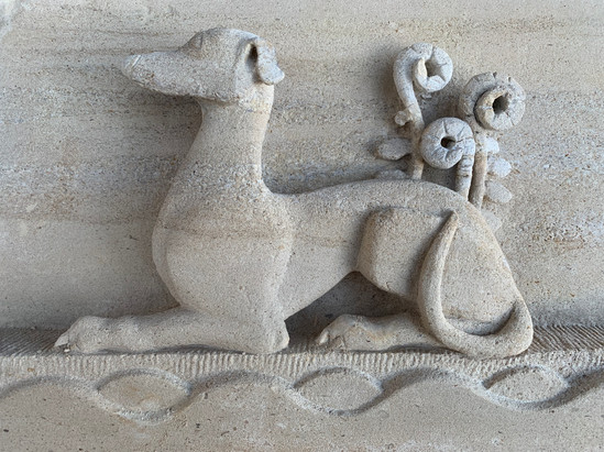 AZ - Whippet stonecarving for book cover.