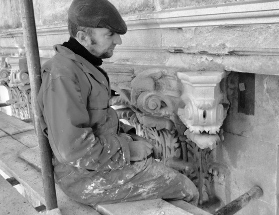 Fixing newly carved volutes toCornthian capital, Camden Crescent, Bath.