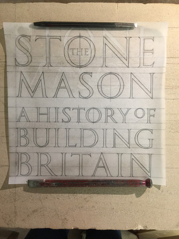 Setting out the cut letters for the book's cover