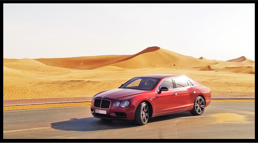 Bentley Flying Spur V8S in the desert of Abu Dhabi