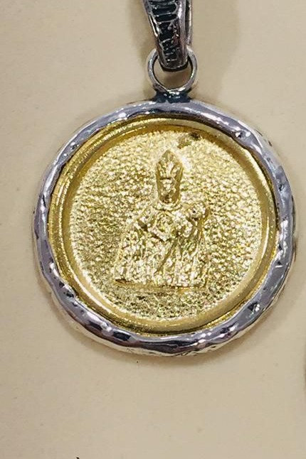Colgante  medalla  pequeño con San Fermín en Plata y Bronce.